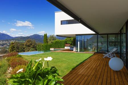 Villa, infinity swimming pool in the garden photo