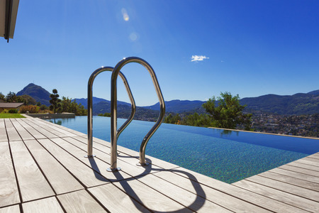 Grab bars ladder in the swimming pool, outdoor photo