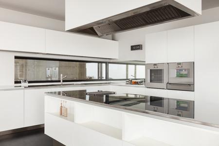 Architecture, beautiful interior of a modern villa, domestic kitchen photo