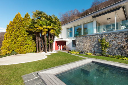 Modern house with swimming pool, view outdoor Stock Photo
