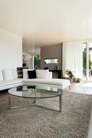 beautiful interiors of a modern house, living room, white divan photo