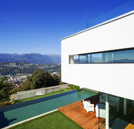 teck: Modern house with pool and garden, summer time