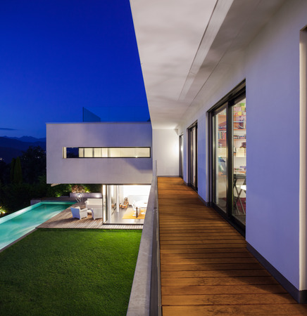 modern house: Modern house with pool and garden, summer time