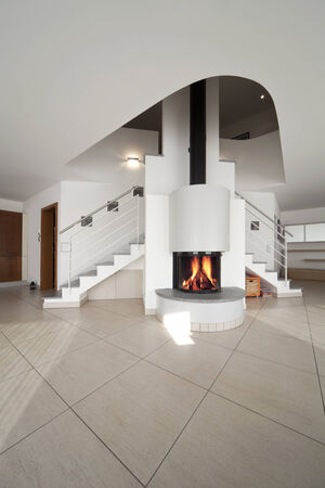 apartment interior with fireplace and stairs photo