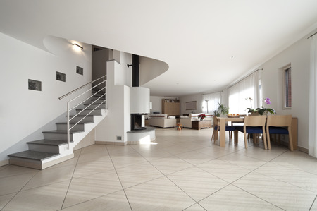 wide livingroom interior with stairs