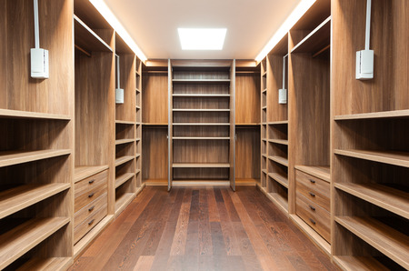 closet: wide wooden dressing room, interior of a modern house Stock Photo