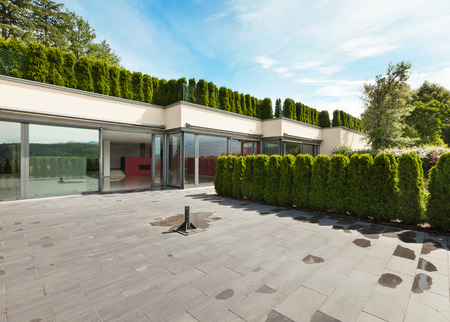 new building construction: modern house with garden, external, view from patio Stock Photo