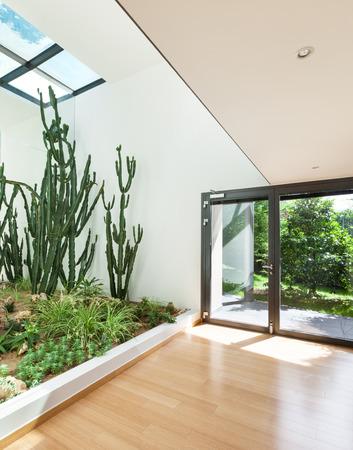 modern garden: entrance of a modern building, interior