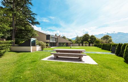modern garden: beautiful modern villa with garden, external