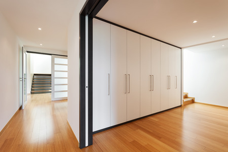 interior of a modern house, long corridor with wardrobes Banco de Imagens