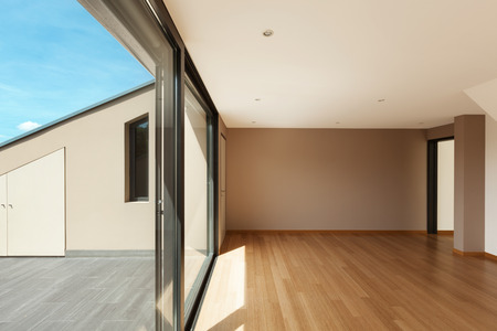 big windows: Interior modern house, wide living room with large window