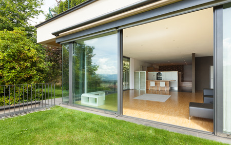 open windows: modern house, wide living room, view from the garden Stock Photo