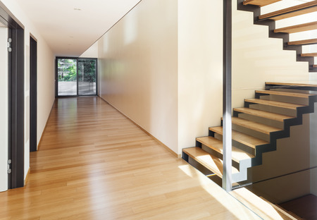 stairs interior: entrance of a modern villa, corridor and stairs view