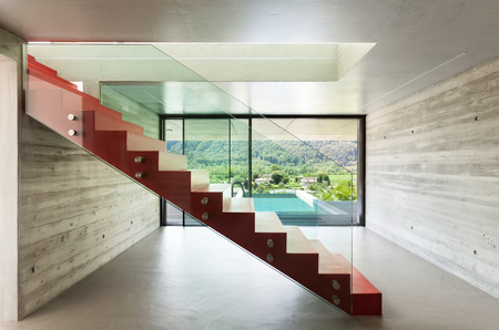 Interior, red staircase in modern villa photo