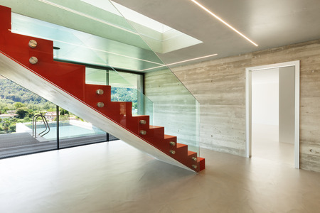 concrete stairs: Interior, red staircase in modern villa Stock Photo