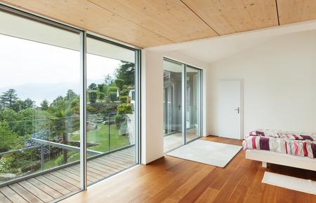 Interior, modern house, bedroom with balcony photo