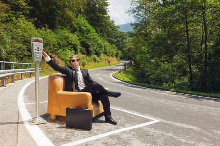 parking space: scene of businessmen who parks his armchair and pay the parking Stock Photo