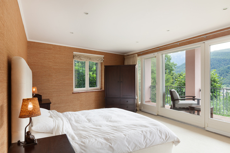 view of a comfortable bedroom: Nice house interior, comfortable bedroom Stock Photo