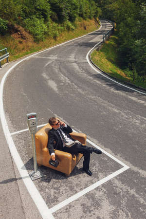 scene of businessmen who parks his armchair and call with old phone photo