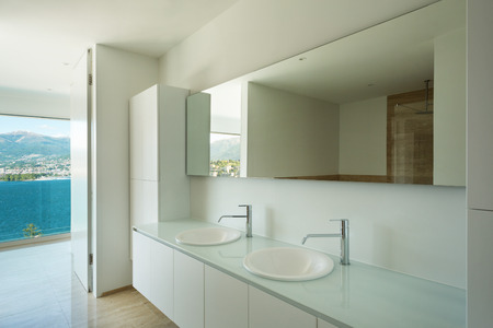 sinks: Modern house, detail bathroom with sinks and mirror Stock Photo
