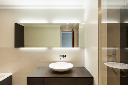beautiful modern bathroom, ceramic basin and mirror