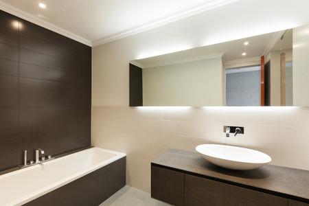 beautiful modern bathroom with ceramic basin and mirror