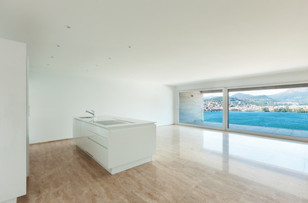 Interior of modern penthouse, empty living room with large windows photo