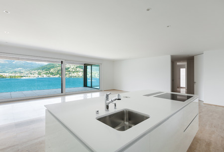 beautiful modern house, wide kitchen with window overlooking the lake photo