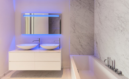 wall mirror: beautiful modern bathroom, marble wall Stock Photo