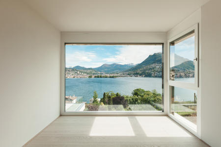 window view: beautiful modern house, empty room with window overlooking the lake