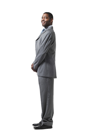 lateral: black businessman portrait standing up over white background