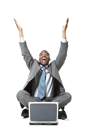 sitted: portrait of black businessman with laptop over white