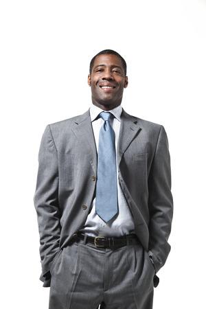 Black businessman half-lenght portrait standing up over white background