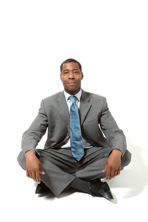 sitted: portrait of black businessman, legs crossed, over white background Stock Photo