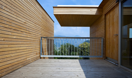 modern house exterior: Wooden balcony