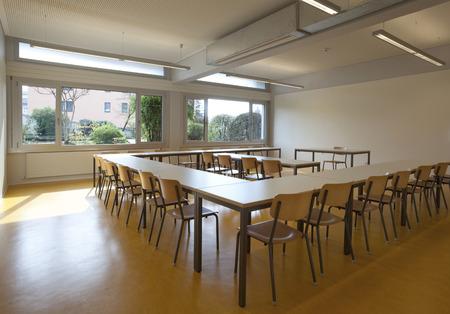 empty classroom: classroom interior, desks and chairs Stock Photo