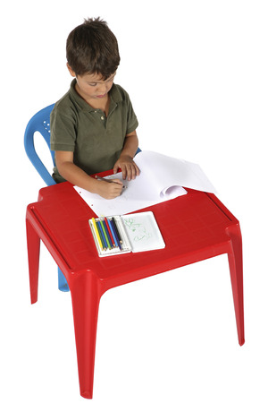 sitted: young boy sitted at the desk Stock Photo
