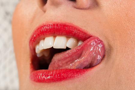 licking tongue: Sensual open mouth, tongue touches the teeth Stock Photo