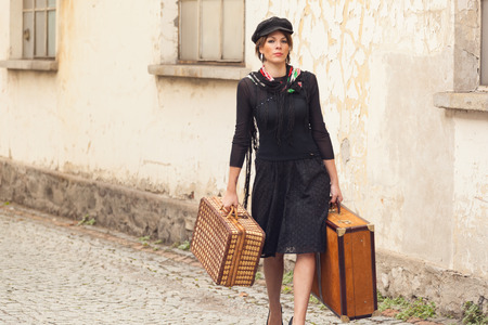 return trip: Woman with luggage arrives at destination Stock Photo
