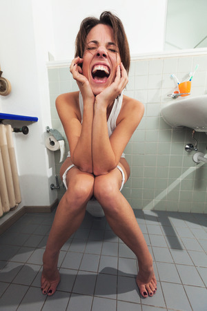screaming woman sitting on the toilet
