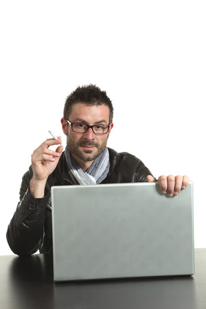 sitted: man portrait, beard and eyeglasses