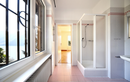 bathroom interior: bathroom interior, tile floor Stock Photo
