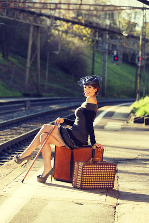 sitted: woman portrait, train station
