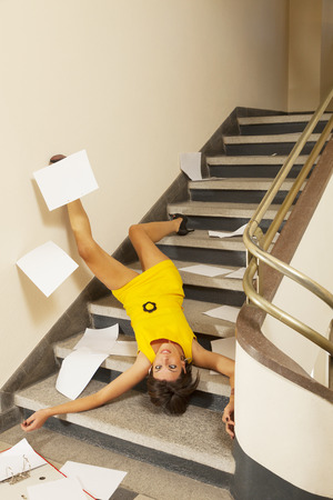 working accident: woman portrait, staircase accident
