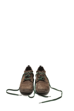 shoestrings: Leather shoes on a white background