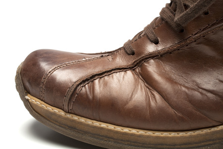 old shoes: Leather shoe on a white background