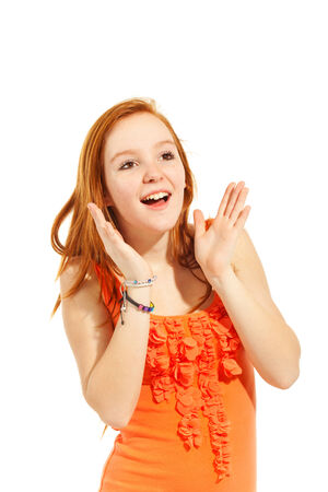 red-haired girl posing in studio