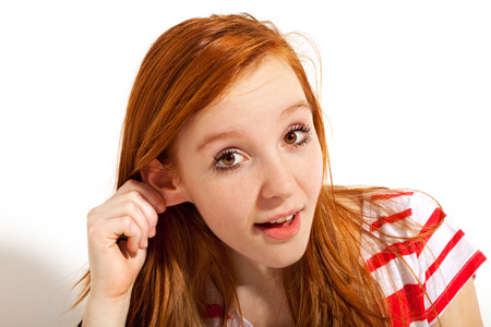 voiceless: red-haired girl posing in studio