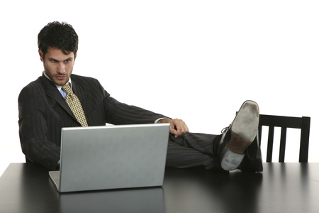 business man studio portrait with computer over white background