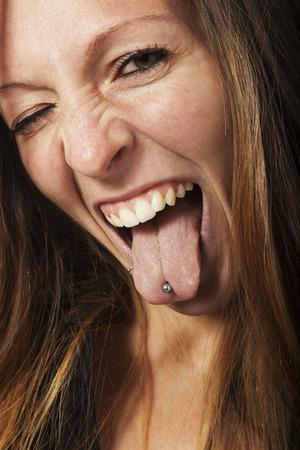 tongue out: girl photo studio portrait